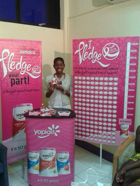 "Wisynco, the Jamaican distributor for Yoplait yogurt, continued their ""Save Lids to Save Lives†commitment where for every 60z of Yoplait sold, they donated JA$8 to the JCS  In Photo: Brand Manager, Tricia Romeo at launch of Breast Cancer Awareness Month.  Photo Courtesy Wisynco Group Facebook Page"