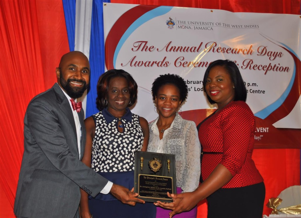 Posing with the award plaque along with co-authors Lovette Byfield, Sannia Sutherland and Roshane Reid